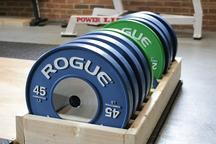 Rogue Competition Bumper Plates in Plate Storage in Garage Gym