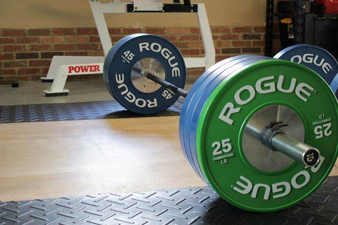 Aesthetic Rogue Competition bumper plates in garage gym