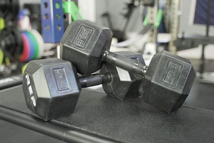 Rep Fitness Rubber Grip Dumbbells laying on side showing label and weight