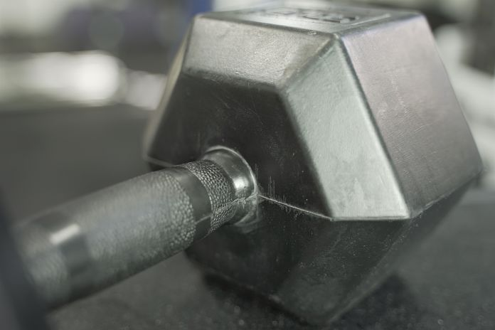 Rubber grip dumbbell showing handle, grip, and friction welded head
