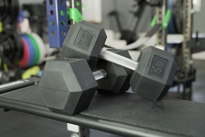 Pair of Rubber Hex Dumbbells lying on side