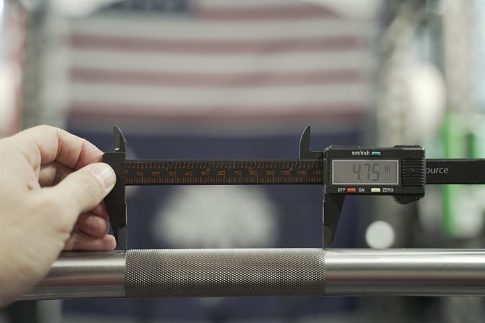 digital calipers are being held to show the length of the center knurl to be 4.75 inches